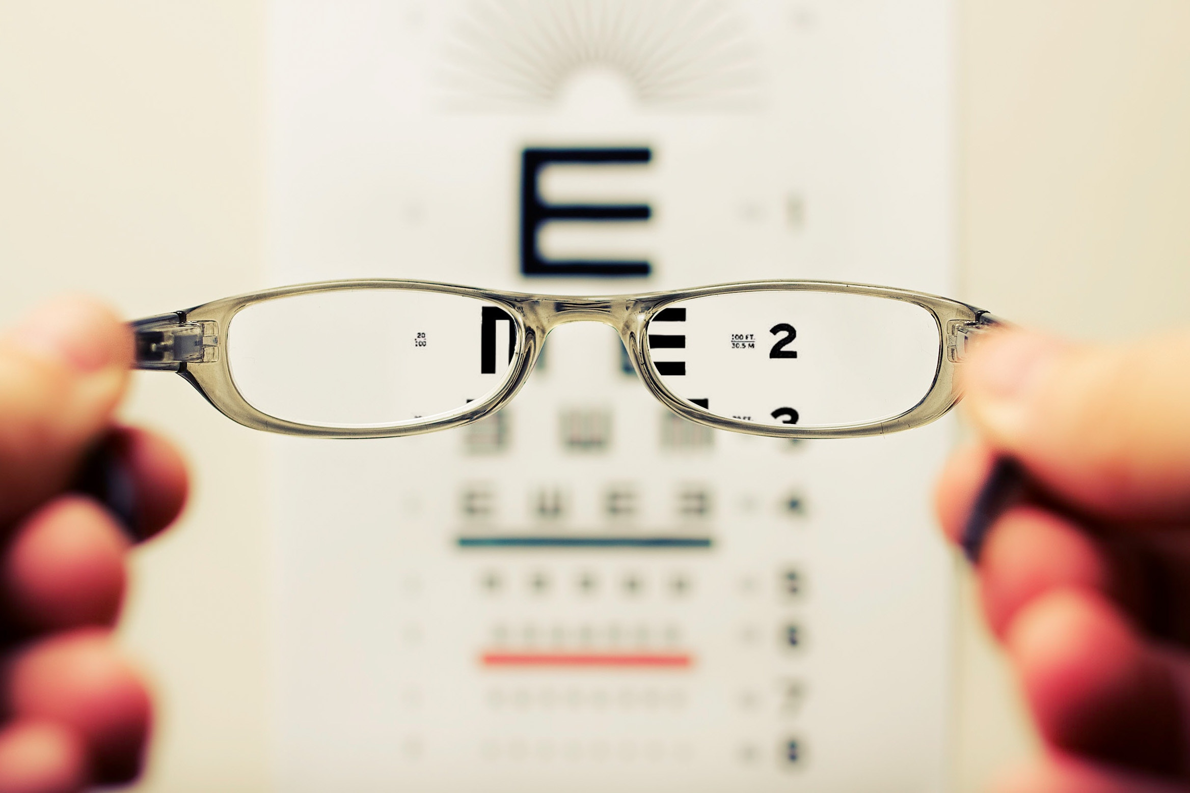 Glasses over eye chart