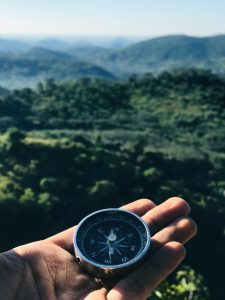 Backpacker holding compass