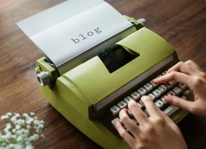 Paper in typewriter says blog